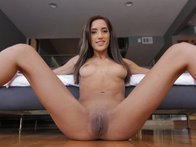 Skinny Latina models her furry jacket and fingers her tiny pussy