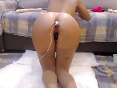 Big ass camgirl with anal vibrator in front of a webcam